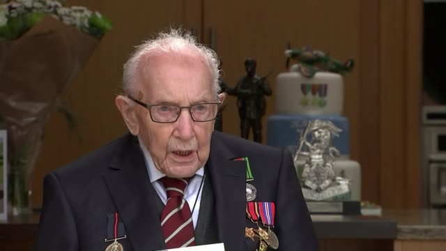 captain tom moore celebrates 100th birthday england bedfordshire captain tom moore interview sot various of tom cutting cake and with family - captain tom moore stock videos & royalty-free footage