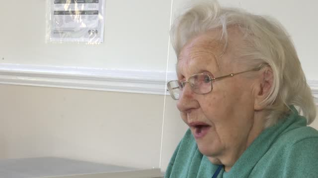 care homes looking forward to visitors from 8th march; england: surrey: surbiton: int gvs elderly woman making burrito as sat in chair dorothy... - finger stock videos & royalty-free footage