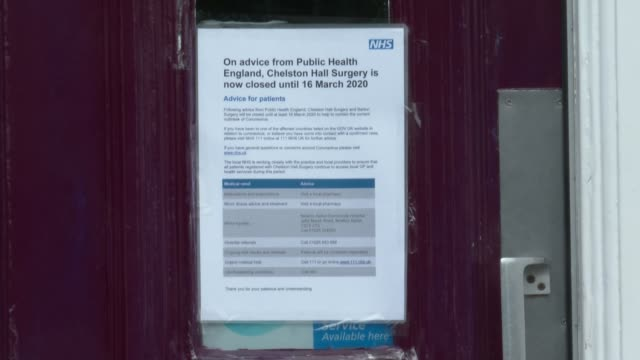 cases in uk rise sharply to 87; england: chelston: ext gv sign 'chelston hall' gv pharmacy and sign 'barton pharmacy' close shot sign on door of gp... - operating stock videos & royalty-free footage