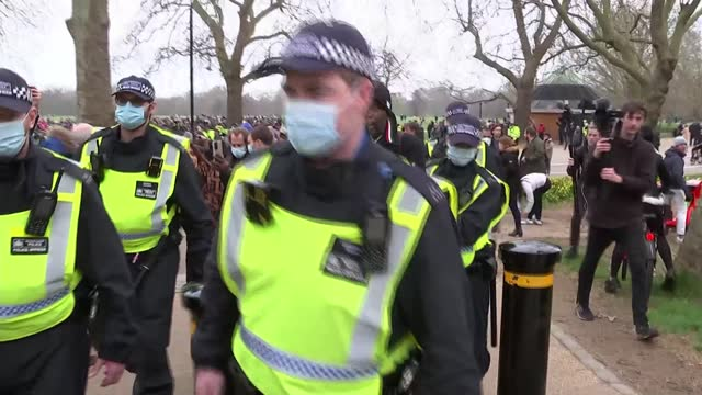 central london anti-lockdown protest: hyde park arrests and scenes; england: london: hyde park: ext gv police pushing crowd and press back as man... - message stock videos & royalty-free footage