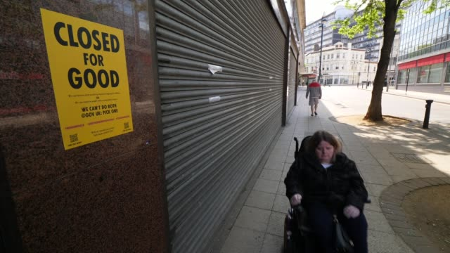 charities struggling to survive despite financial support from government england london lisa davis away down street in motorised wheelchair side... - wheelchair stock videos & royalty-free footage