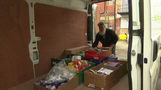 charties to get cash in injection; england: lincolnshire: lincoln: ext man loading boxes of food in to van at food bank for home deliveries close... - loading stock videos & royalty-free footage