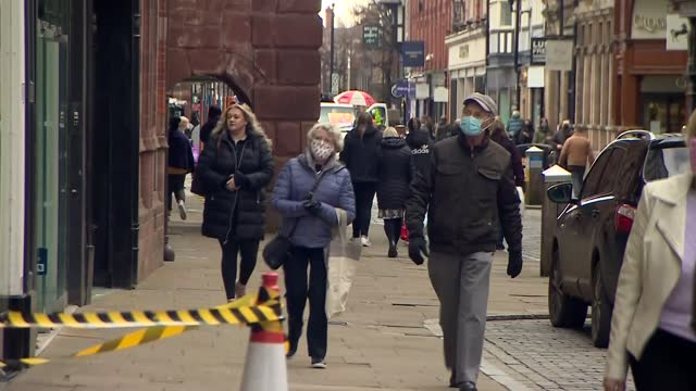 chester reopening shopping scenes; england: cheshire: chester: ext various of shoppers along high street past shops, some wearing masks / shoppers... - shopping stock videos & royalty-free footage