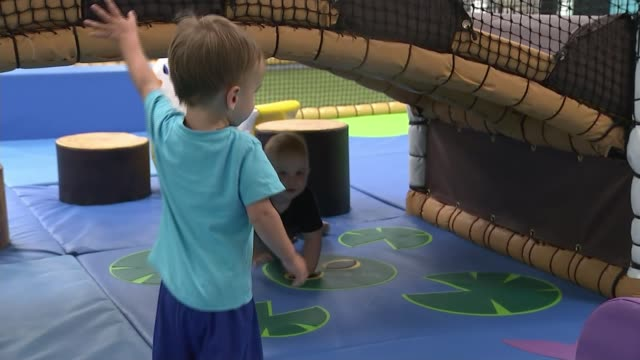 children's indoor play areas are reopening in wales wales newport int various shots of children playing at soft play centre - politics stock videos & royalty-free footage