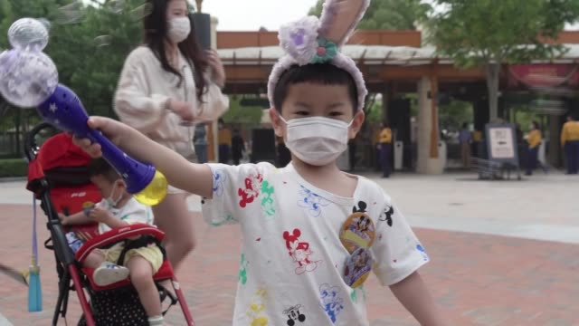 china's disneyland reopens in shanghai china shanghai ext various shots of chinese tourists along to disneyland various shots of nutta sun and family... - shanghai stock videos & royalty-free footage