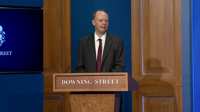 chris whitty, boris johnson and nicki minaj in war of words over vaccine jabs; england: london: downing street briefing room: int professor chris... - war and conflict stock videos & royalty-free footage
