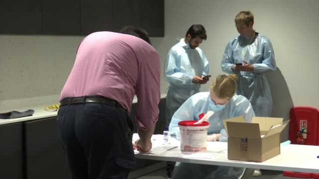 city firms providing covid19 tests to encourage employees back into office uk england london various shots of office workers being tested for covid19... - giving stock videos & royalty-free footage