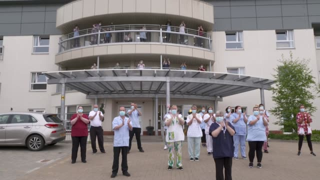 clap for carers; england: east london: bow: ext residents clapping outside housing estate and banging pots and pans sot scotland: glasgow: medics... - cooking pan stock videos & royalty-free footage