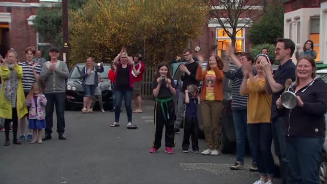 'clap for carers' nottingham scenes england nottingham gvs people waiting in street together some with pots and pans waiting to take part in 'clap... - ladle stock videos & royalty-free footage