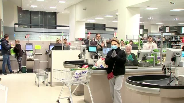 'clap for carers' returns for a second week; england: int shoppers and staff in waitrose supermarket stand and applaud in support of nhs staff and... - nhs stock videos & royalty-free footage