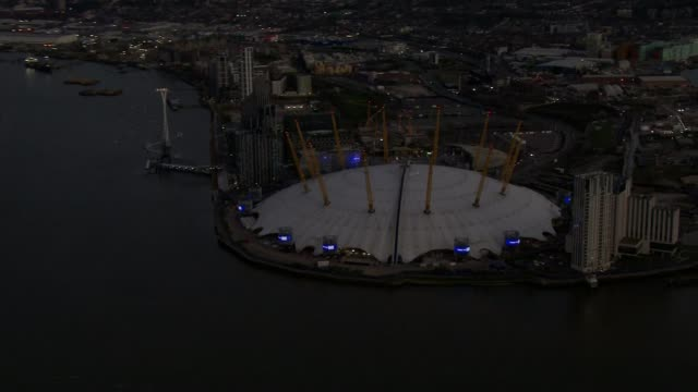 'clap for carers' returns for a second week; england: london: ext / dusk air views / aerials o2 centre with blue lights - in support of nhs staff and... - illuminated stock videos & royalty-free footage