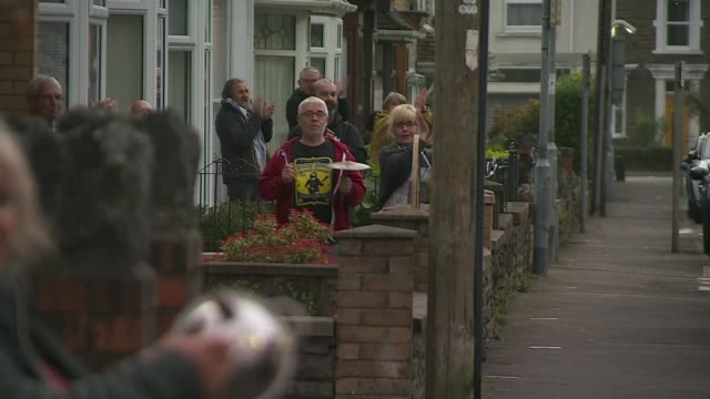 'clap for carers' returns for a second week wales neath ext people stand on doorsteps clapping and cheering in support of nhs staff and carers clap... - nhs stock-videos und b-roll-filmmaterial