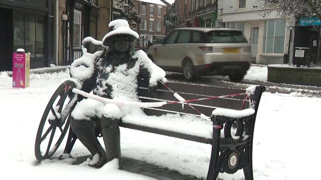 coldest january for ten years and february snow contribute to missed vaccination appointments; england: yorkshire: ext / snow people along snowy... - weather stock videos & royalty-free footage