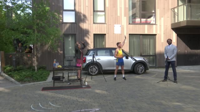 comedian ryan hand to run 'london marathon' outside his flat; england: london: ext reporter and comedian ryan hand outside the flats where he lives... - beginnings stock videos & royalty-free footage