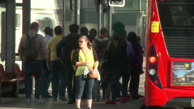 commuters wearing masks at vauxhall station; england: london: vauxhall: ext various of commuters into and out of vauxhall station, through ticket... - commuter stock videos & royalty-free footage
