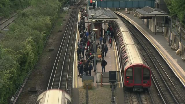 concerns that too few people wearing masks on public transport as people begin return to work; england: london: elephant and castle: ext gv bus stop... - commuter stock videos & royalty-free footage