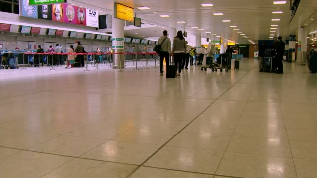 'confusing' quarantine rules could change again within days as portugal teeters on brink; scotland: glasgow airport: int passengers queue at airport... - portugal stock videos & royalty-free footage