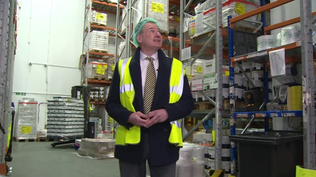 confusion over which shops are considered essential england london harvey brockless warehouse int reporter to camera lift truck moving pallet off... - journalist stock videos & royalty-free footage