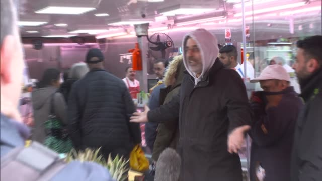 country in complete lockdown england london harrow ext queue of shoppers at grocery stall vox pops including woman shopper wearing medical face mask - france stock videos & royalty-free footage