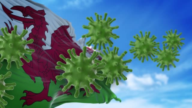 coronavirus covid-19 are spreding to the sky or cleaning from welsh flag in 4k resolution - wales stock videos & royalty-free footage