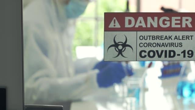 coronavirus covid-19 laboratory - sample holder stock videos & royalty-free footage