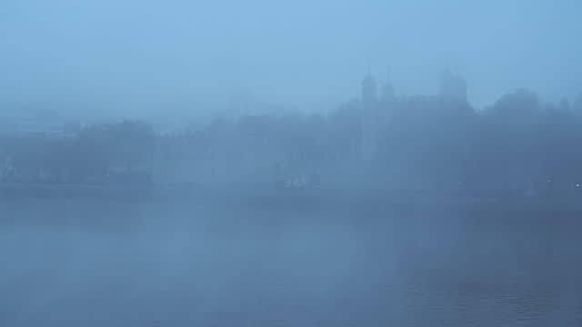 coronavirus covid-19 lockdown day one in thick foggy weather conditions at tower of london on a misty cool blue atmospheric morning with fog and mist on the river thames in london, england, uk - tower of london stock videos & royalty-free footage