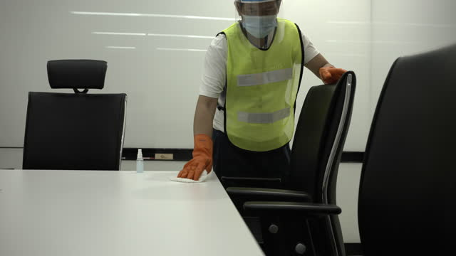coronavirus covid-19 prevention cleaning man wiping cleaning tables in with antibacterial disinfecting wipe for killing corona virus on surfaces public meeting room handle with antiseptic sanitizer. - control stock videos & royalty-free footage