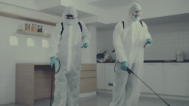 coronavirus , covid19 : protective suit makes disinfection - kitchen worktop stock videos & royalty-free footage