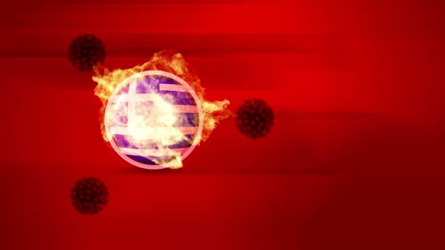 coronavirus covid-19 viruses are firing up greek flag and flag burns in 4k resolution - greek flag stock videos & royalty-free footage