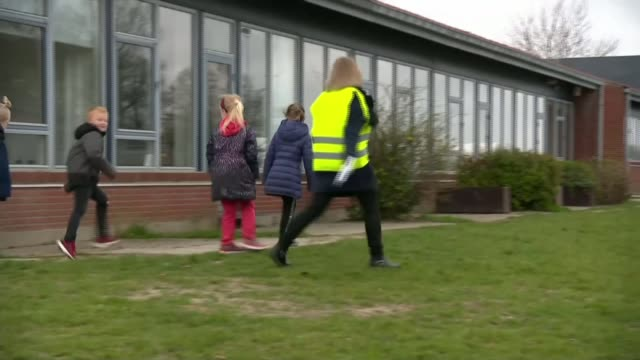denmark reopens primary schools; denmark: copenhagen: ext gv woman wearing high visibility vest along with children close shot hand sanitiser... - vest stock videos & royalty-free footage