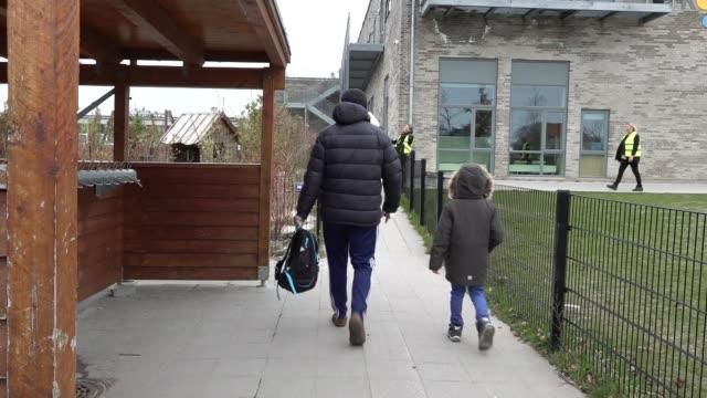 denmark reopens primary schools england london gir int reporter to camera james kristoffer miles live 2way interview sot denmark copenhagen ext rear... - danimarca video stock e b–roll