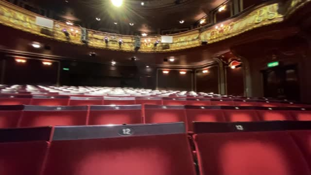 devastating impact of pandemic on theatre and arts; england: london: int nica burns interview sot posters on doors 'we'll be back soon' empty seats... - auditorium stock videos & royalty-free footage