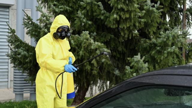 コロナウイルスの消毒 - クリーンスーツ点の映像素材/bロール