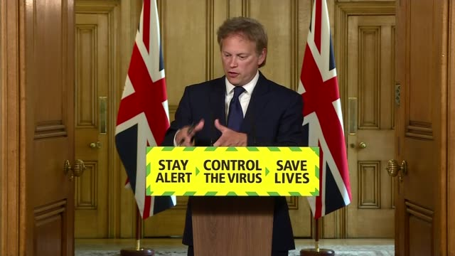 dominic cummings denies accusations of breaking lockdown rules; england: london: westminster: downing street: int various of grant shapps mp and dr... - fade in video transition stock-videos und b-roll-filmmaterial