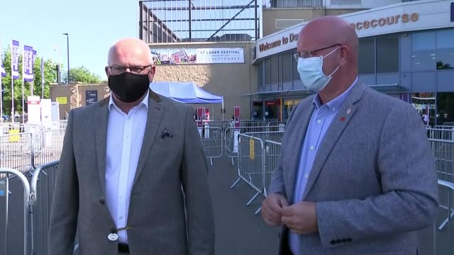doncaster races to take place behind closed doors; uk, doncaster; races, racecourse, horse racing, face mask, queue, barriers, social distancing,... - competition stock videos & royalty-free footage