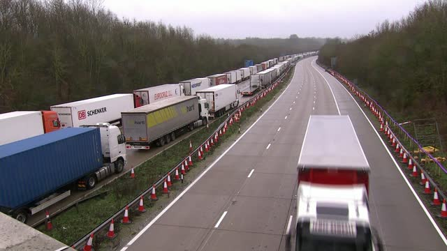 dover border closure impacts uk supply chain; kent, uk; point of view shots from car along motorway past lorries, various shots of lorries queuing on... - windscreen stock videos & royalty-free footage
