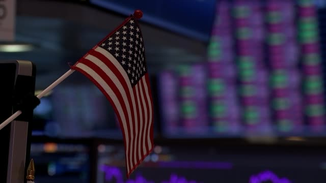 dow jones slumps as trump presidency market gains wiped out; usa: new york: new york stock exchange: int us flag pull focus board showing stock... - new york stock exchange stock videos & royalty-free footage