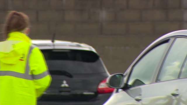 drive through testing centre in belfast; northern ireland: belfast: ext tents, portable toilets and traffic cones in place in car park and testing... - radio stock videos & royalty-free footage