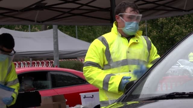 drivethrough testing station at barnet england london barnet various shots of soldiers wearing face mask and eye protection speaking to occupants of... - eye stock videos & royalty-free footage
