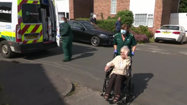 elderly women survivors' stories england nottinghamshire ext sequence 86yearold barbara briley wheeled from ambulance and to house as her daughter... - ambulance stock videos & royalty-free footage