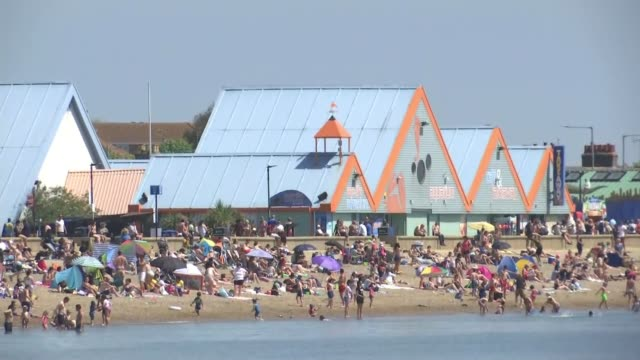 england's beaches busy on hottest day of the year to date england southend ext wide shot busy beach packed with beachgoers and sunbathers gv people... - multi coloured stock videos & royalty-free footage