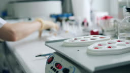 Coronavirus epidemia, virus vaccine concept. Laboratory machine is analyzing probes of blood