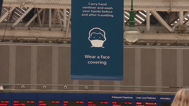 coronavirus face covering sign at glasgow central station as it is now compulsory to wear one on public transport in scotland as lockdown... - public transport stock videos & royalty-free footage