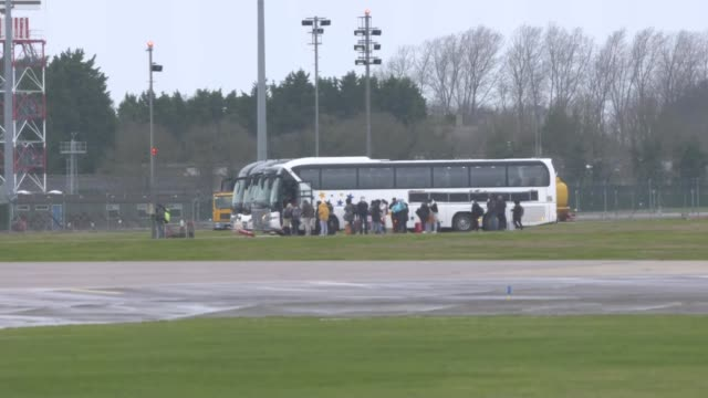 final repatriation flight arrives to raf brize norton; england: oxfordshire: raf brize norton: ext people from wuhan repatriation flight boarding... - oxfordshire stock videos & royalty-free footage