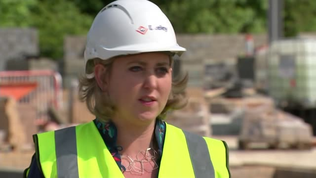 firms keen to reopen as soon as possible and adapting to survive; uk; various shots of construction site, with diggers and workers at work and along,... - chopped lettuce stock videos & royalty-free footage