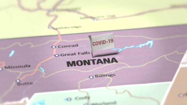 coronavirus flag on montana - montana western usa stock videos & royalty-free footage