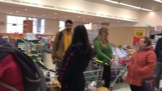 food retailers call on shoppers to 'be considerate' and stop stockpiling; england: london: int various of people queuing with trolleys in supermarket - groceries stock videos & royalty-free footage