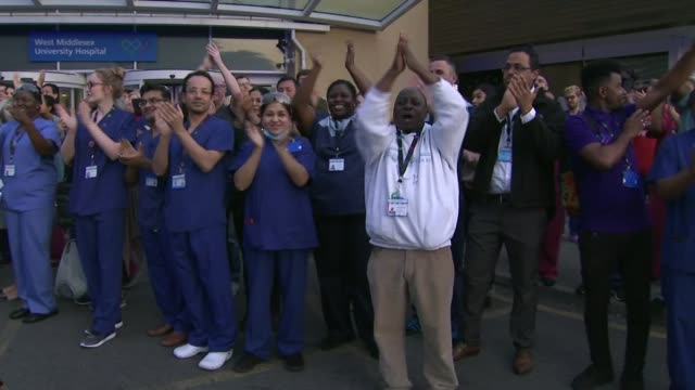 fourth 'clap for carers' event england london ext people stand in their front garden applauding nhs workers and carers clap for carers west middlesex... - nhs stock-videos und b-roll-filmmaterial