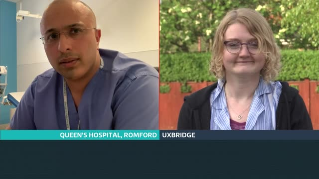 stockvideo's en b-roll-footage met fourth 'clap for carers' event; england: london: gir: int reporter to camera dr sarfaraz munshi and rhianna colyer live 3-way interview sot - itv