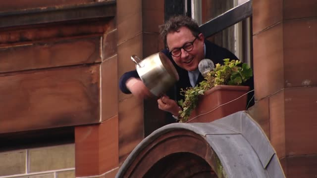 fourth 'clap for carers' event scotland glasgow ext people lean out of their windows and applaud and cheer some banging pots and pans applauding nhs... - cooking pan stock videos & royalty-free footage